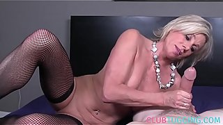 Busty gilf tugging and stroking POV cock